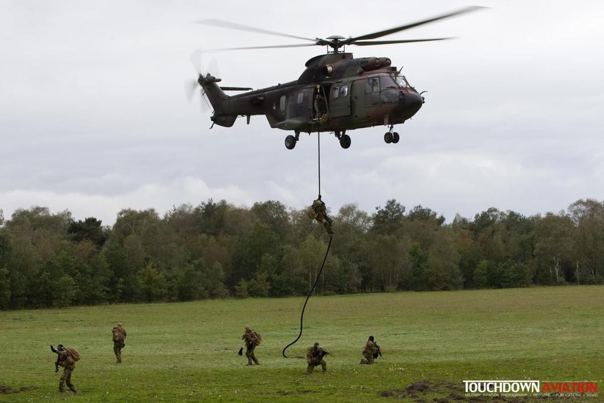 A Cougar delivers troops to relieve the downed pilot at the Arnhemse heath