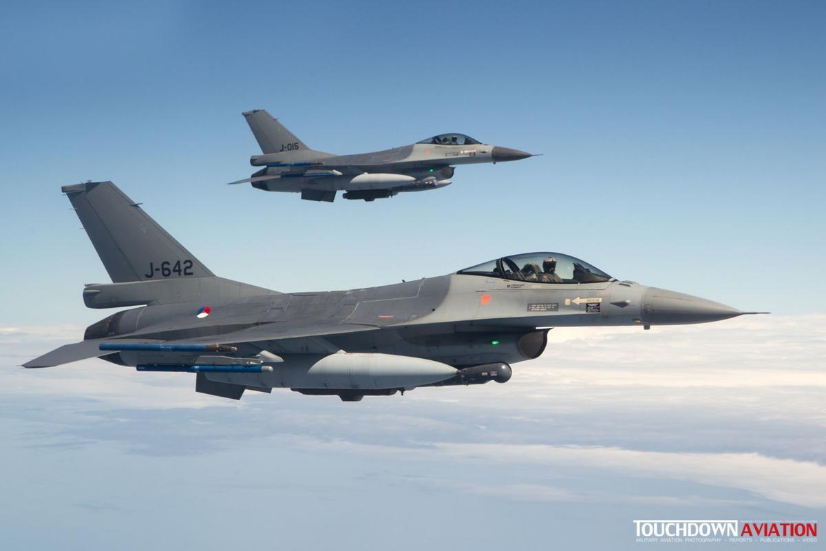 Two RNLAF F-16s fly alongside the KDC-10 tanker