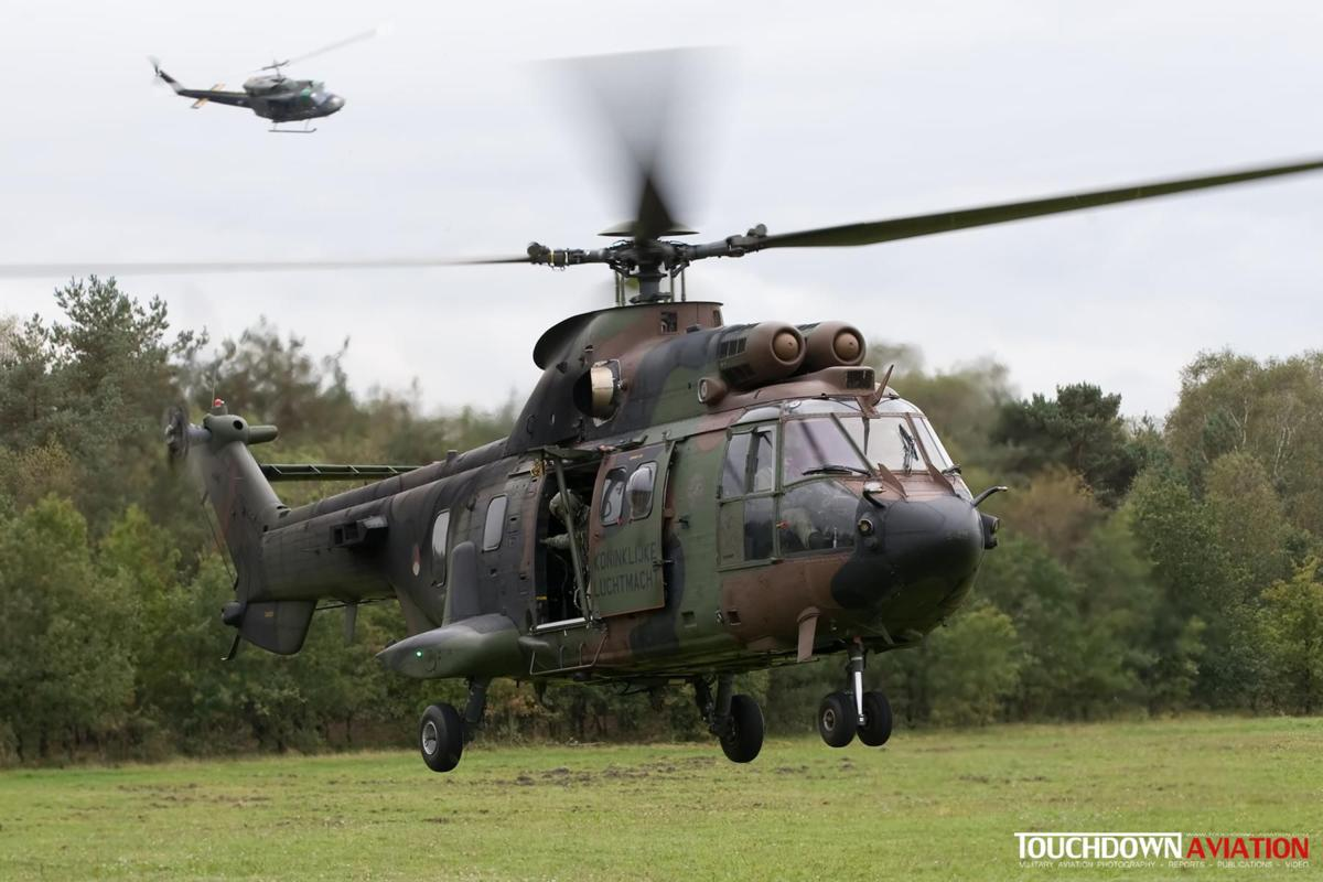 The Cougar lands to relieve the downed pilot at the Arnhemse heath